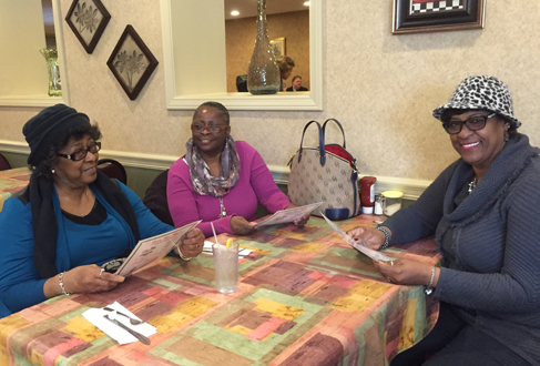 Three women friends smiling and having lunch at Ricardo's Restaurant in Erie, PA.